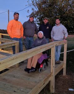 Anna with the crew that built her new ramp.